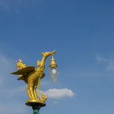 Golden bird lantern on the top of pole Royalty Free Stock Images