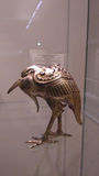 Golden bird sculpture. Museum exhibit in the form of a golden bird similar to a crow or heron. Japan medieval sculpture Stock Photos