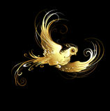 Golden bird. Shiny, golden, artistically painted bird on a black background stock illustration
