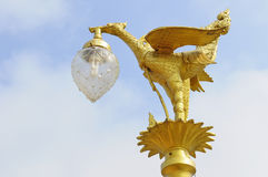 Golden bird statue on the top of pole Royalty Free Stock Photography