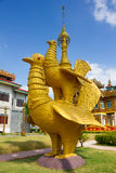Golden bird statue in Wat Thai Wat Tha Na Ram temple in Mae sot, Tak, Thailand Stock Photo