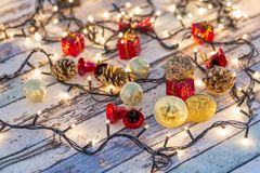 Golden bitcoin and another bitcoin in back with christmas decors royalty free stock photography