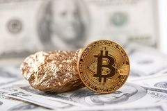 Golden bitcoin as main world cryptocurrency and gold lump presented on dollar banknote background. Trend futuristic blockchain digital virtual electronic money royalty free stock images