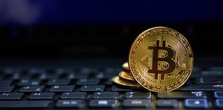 Bitcoin on a black laptop. Golden bitcoin on a black computer keyboard stock photos
