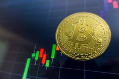 Golden Bitcoin on black laptop screen with stock exchange graph. Background. Digital money concept Royalty Free Stock Image