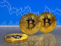Golden bitcoin on blue abstract finance background. Bitcoin cryptocurrency. Golden bitcoin on blue abstract finance background. Bitcoin cryptocurrency Stock Images