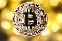 Golden bitcoin  on blurred light background Royalty Free Stock Image