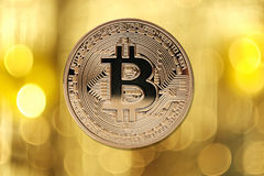Golden bitcoin  on blurred light background Royalty Free Stock Photos