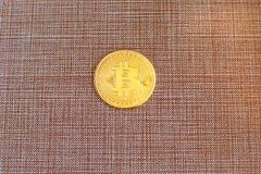 Golden bitcoin on brown background. Bitcoin crypto currency, Blockchain technology, digital money. Golden bitcoin on brown background.Bitcoin crypto currency royalty free stock photo