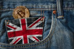 Golden BITCOIN & x28;BTC& x29; cryptocurrency in the pocket of jeans with. The flag of United Kingdom & x28;UK& x29; flag or Union Jack flag stock photos