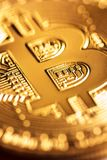 Golden bitcoin close-up Royalty Free Stock Image