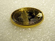 Golden bitcoin. Closeup of golden bitcoin on soft background Stock Photos