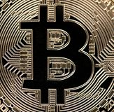Golden Bitcoin Coin Close Up royalty free stock image