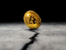 Golden bitcoin coin on cracked concrete floor crypto Currency ba Stock Images