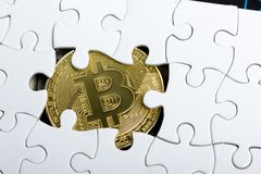 Golden bitcoin coin. cryptocurrency. Missing jigsaw puzzle pieces. Business concept. Compliting final task.  stock image