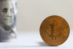 Golden Bitcoin and banknotes Royalty Free Stock Photography