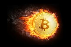 Golden bitcoin coin flying in fire flame. Stock Images