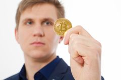 Golden bitcoin coin with gold symbol in man hand isolated on white background. Businessman and success concept. Selective focus. And copy space Stock Photos