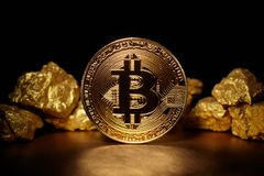 Golden Bitcoin Coin and mound of gold stock photography