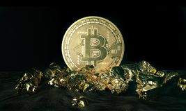Golden Bitcoin Coin and mound of gold. Bitcoin cryptocurrency. Business concept. Stock Images