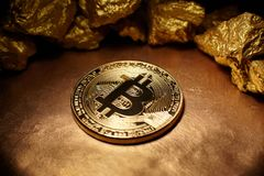 Golden Bitcoin Coin and mound of gold Stock Images