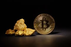 Golden Bitcoin Coin and mound of gold Stock Photos
