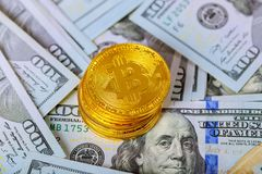 Golden bitcoin coin on us dollars close up. Electronic crypto currency. Cryptocurrency and worldwide payment system golden bitcoin coin on us dollars close up royalty free stock image