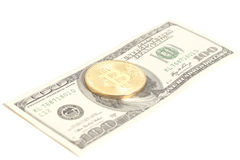 Golden bitcoin coin on us dollars Stock Image