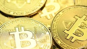Golden bitcoin coins. Bitcoin cryptocurrency. Golden coins on laptop keyboard, macro shot with tilt stock video