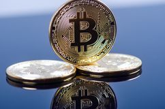 Golden bitcoin coins on a dark background with reflection. Virtual currency. Crypto currency. New virtual money. Golden bitcoin coins on a dark background with stock photo
