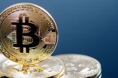 Golden bitcoin coins on a dark background with reflection. Virtual currency. Crypto currency. New virtual money. Golden bitcoin coins on a dark background with royalty free stock images