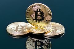 Golden bitcoin coins on a dark background with reflection. Virtual currency. Crypto currency. New virtual money. Golden bitcoin coins on a dark background with stock images