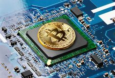 Golden Bitcoin on a processor Stock Images