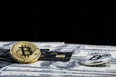 Golden bitcoin with credit card on top of dollar banknote backgr. Ound, new currency, accepting bitcoin for payment, finance concept, copy space Stock Photography