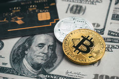 Golden bitcoin with credit card on top of dollar banknote backgr. Ound, new currency, accepting bitcoin for payment, finance concept Stock Photography