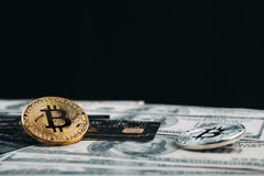 Golden bitcoin with credit card on top of dollar banknote backgr. Ound, new currency, accepting bitcoin for payment, finance concept, copy space Royalty Free Stock Image