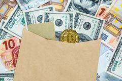 Golden Bitcoin Crypto currency coin in the envelope with dollar banknotes and credit card. Investments, cryptocurrency digital pay. Ment concept, new money or stock images