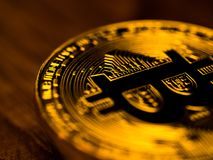 Golden bitcoin cryptocurrency banking money transfer business technology on wooden table. Concept of distributed ledger technology Royalty Free Stock Images
