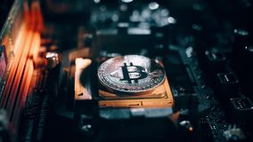 Golden bitcoin cryptocurrency on a computer board. Macro shooting. The concept of cryptocurrency with coins, bitcoin on