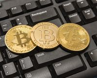 Golden Bitcoin Cryptocurrency on computer keyboard Royalty Free Stock Photos