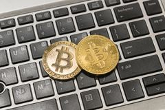 Golden Bitcoin Cryptocurrency on computer keyboard Royalty Free Stock Images
