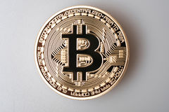 Golden bitcoin cryptocurrency  on white background Royalty Free Stock Photo