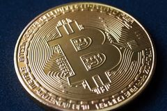 Close-up of a golden bitcoin currency Stock Image
