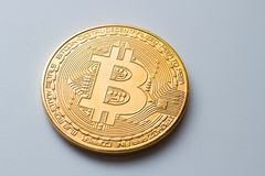Close-up of a golden bitcoin currency in isolated background Royalty Free Stock Photos