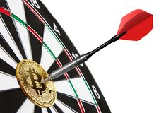 Golden Bitcoin on a dartboard with dart stock image