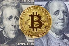 Golden bitcoin on dollar bills background. Stock Photo