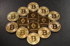 Golden bitcoin and ethereum coins. Cryptocurrency concept. Stock Photos