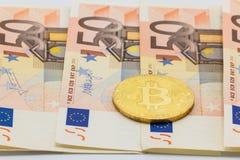 Golden Bitcoin on 50 Euro. Electronic money exchange concept Stock Photo