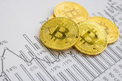 A golden bitcoin on graph background. trading concept of crypto currency. Photo stock images