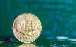 Golden bitcoin on green board with microchips and microcircuits on background. Concept of cryptocurrency, electronic payments and web banking Royalty Free Stock Photography